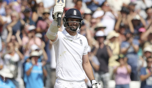 England's James Anderson raises his bat at Trent Bridge after scoring his maiden fifty