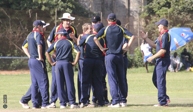 MCC huddle following the fall of a Uganda wicket