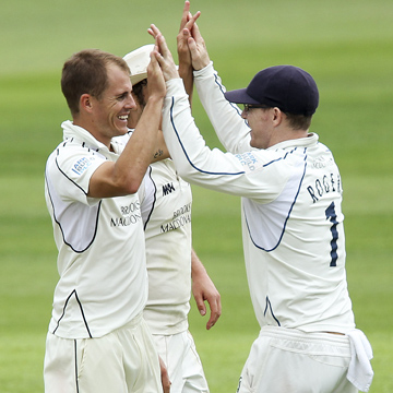 Neil Dexter celebrates a wicket