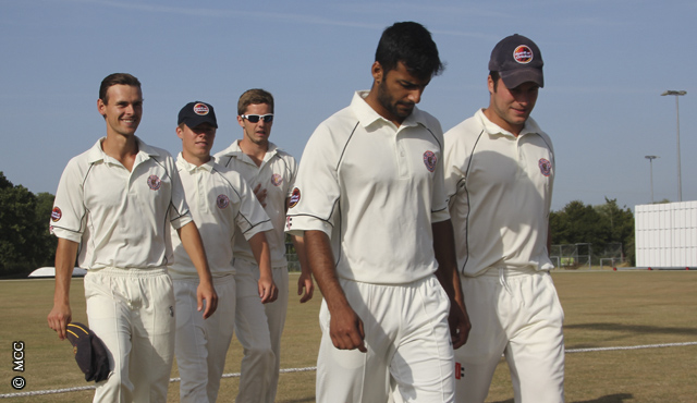 The MCCU Combined XI leave the field at Canterbury