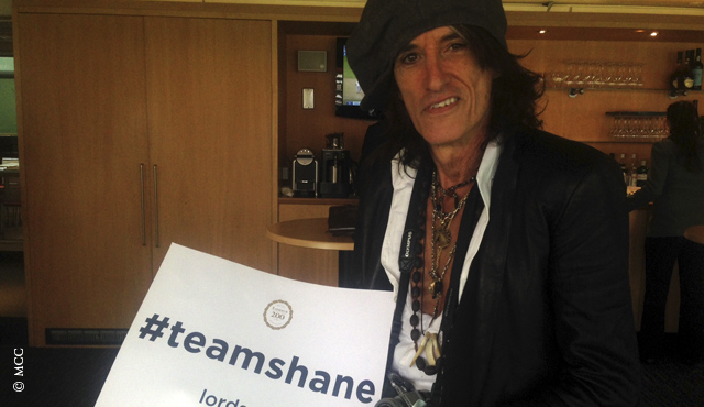 Aerosmith guitarist Joe Perry shows his support for Team Shane on day five of the Test