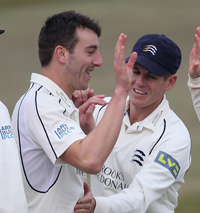 Toby Roland-Jones celebrates a wicket