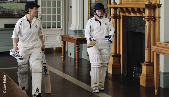 Claire Taylor (l) strolls out to bat through the Long Room