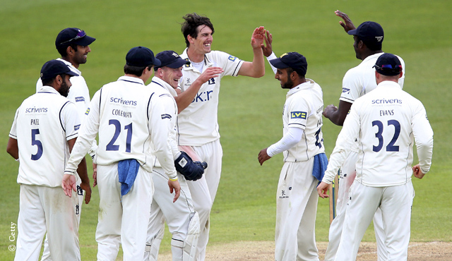 Warwickshire celebrate a Chris Wright wicket