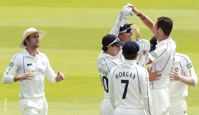 Middlesex players celebrate a wicket
