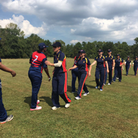 mcc and usa players shake hands