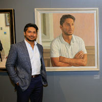 kumar sangakkara with his portrait