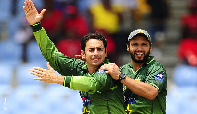 Saeed Ajmal and Shahid Afridi celebrate a wicket for Pakistan